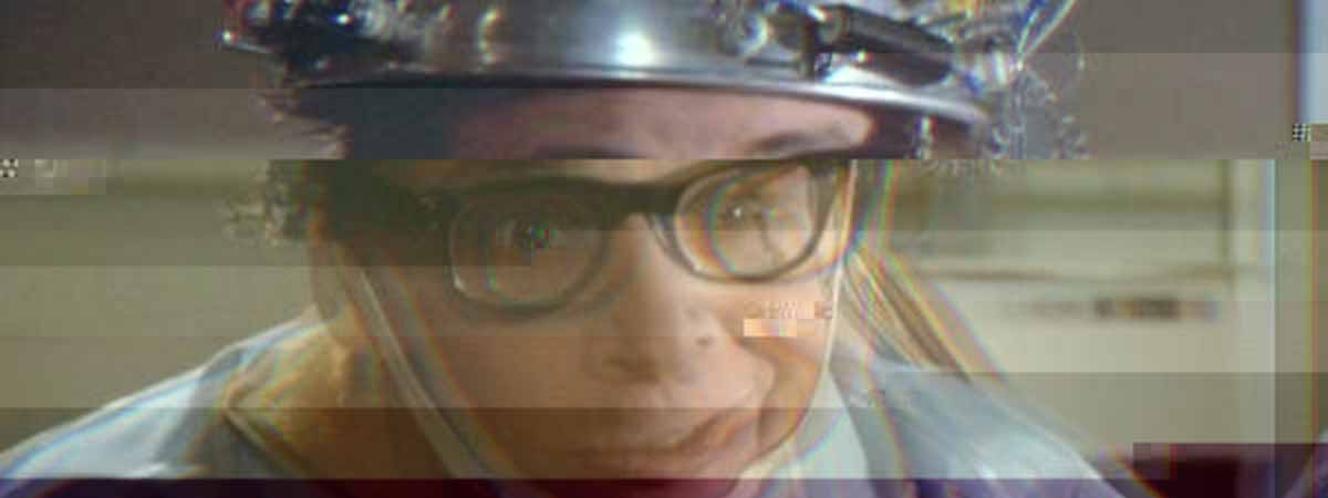 Rick Moranis in Ghostbusters with a brain scanner on his head