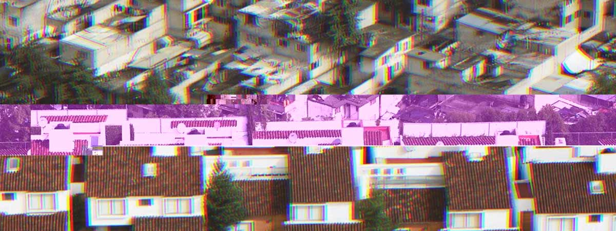 A fence in Mexico City delineating a poor area from a wealthy area