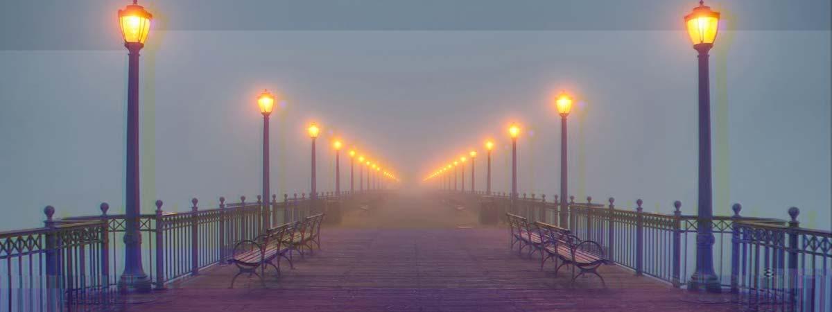 Foggy illuminated pier